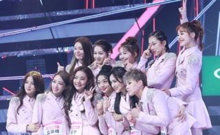 Girl group Rocket Girls pose on stage in Hangzhou, China