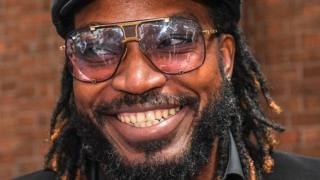 Chris Gayle smiles after winning the case