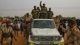 """General Abdel Fattah al-Burhan, the head of Sudan""""s ruling military council, greeting supporters in Omdurman on 29 June"""