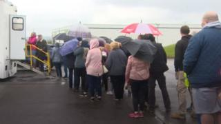 People queuing for TB screening session in Llwynhendy