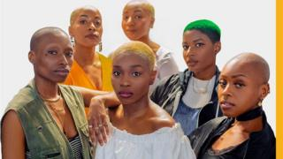 A group of bald black women