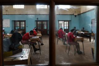 Pupils from Nairobi primary school sit for their exams at the start the Kenya Certificate of Primary Education (KCPE) examinations in Nairobi on October 29, 2019. - A total of 1,088,986 candidates writing the tests that mark their transition to secondary schools. The Kenya Certificate of Primary Education (KCPE) is a certificate awarded to students after completing the approved eight-year course in primary education and transition to secondary education thereafter.