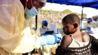 A Congolese health worker administers ebola vaccine to a child at the Himbi Health Centre in Goma
