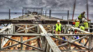Volunteers working on the Queen's Pier restoration project