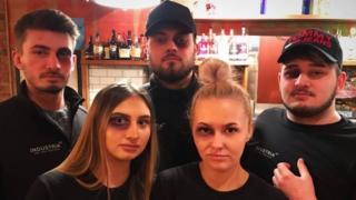 Bar staff with black eye make-up