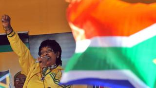 A file photo of Winnie Madikizela-Mandela addressing members of South Africa's ruling party African National Congress (ANC) during a street party on 4 June 2010