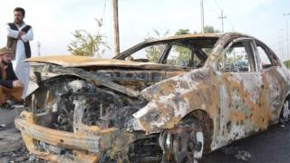 Remains of car destroyed in bombing at Amiryat Falluja