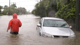 A man walks through floodwaters in Rosslea, Townsville, Queensland, Australia, 2 February 2019