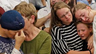 The mother (left) and family of Rina Shnerb mourn at her funeral in the Israeli town of Lod (23 August 2019)