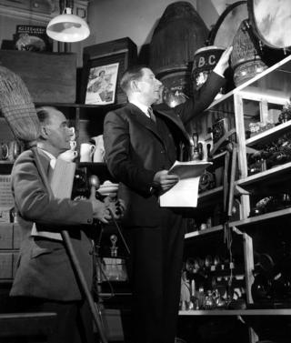 Jack Holden and Charles Willis checking a script for effects needed in a programme.