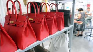 Birkin bags on shelf
