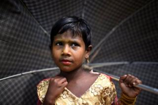 Rohingya refugee Zinu Ara, aged 4, poses for a photograph as she wears thanaka paste at Balukhali camp in Cox's Bazaar, Bangladesh