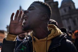 A man takes part in a demonstration against the CFA franc in Rome, Italy, on 2 March 2019.
