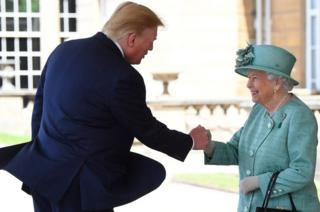 Britain's Queen Elizabeth II shakes hands with US President Donald Trump during a welcome ceremony at Buckingham Palace