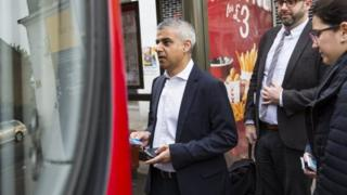 Sadiq Khan takes the bus to work on his first day as mayor of London