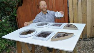 Daniel Roberts creating the poo-filled windows