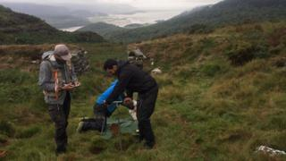 Soil samples being taken on Welsh hillside