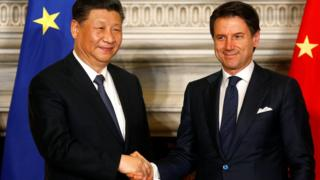 Italian Prime Minister Giuseppe Conte and Chinese President Xi Jinping shake hands after signing trade agreements at Villa Madama in Rome.