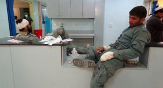 Afghan police who were injured in a suicide bomb attack that targeted a police post, receive medical treatment at a hospital in Paktia, Afghanistan, on 17 October 2017.