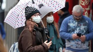 Women wearing face masks in Soho, London