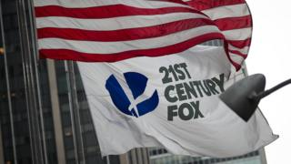 A 21st Century Fox flag flies outside the News Corporation building in Midtown Manhattan, December 14, 2017 in New York City.