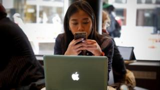 Woman using Apple Mac