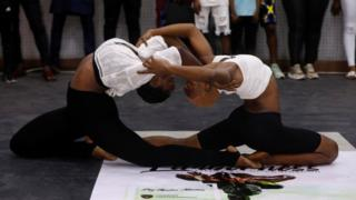 Ifeoma Amazobi, 22, and her colleague perform contortions at a show called Limberness in Lagos, Nigeria, on 1 February 2020