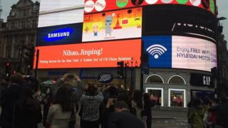 A greeting for China's leader Xi Jinping flashes in London's Piccadilly Square