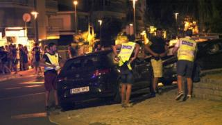 Police in Cambrils inspect the car used in an attempted attack, 18 August 2017