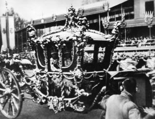 The Royal Coach passing the television camera at Apsley Gate.