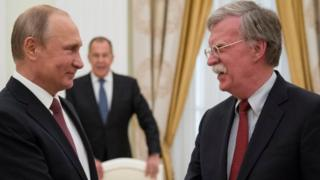 Russia's President Vladimir Putin (L) shakes hands with US National Security Adviser John Bolton during a meeting at the Kremlin in Moscow on 27 June 2018