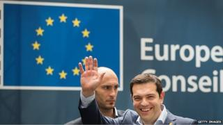 Alexis Tsipras, Greece's prime minister, waves as he departs a EU summit meeting in Brussels, Belgium