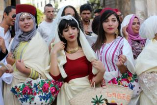 "Tunisian women wearing traditional veils called ""Sefseri"" during the celebrations of the National Women""s Day and the 61th anniversary of the Personality Status Code in Tunis, Tunisia on 13 July 2017"
