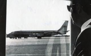 Airline official Norman Kaye looks out at hijacked TWA85 at Bangor airport, Maine