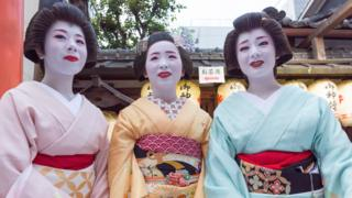 Two geishas and a trainee, Kyoto, Japan, 2016