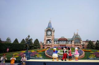 Performers in a ceremony marking the reopening of Shanghai Disneyland