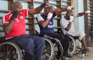 Kenyan para-boxers throw punches at each other during a training session at a social hall in Nairobi, Kenya, 16 November 2018.