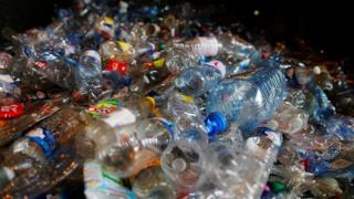 A file image of a pile of plastic bottles at a recycling plant