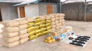 Weapons, ammunition, alongside bags of crystal methamphetamine