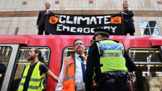 Protestors on top of a train during an Extinction Rebellion protest