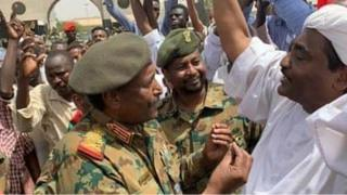 A handout picture released by the Twitter account of the official Sudan News Agency (SUNA) on April 12, 2019 shows Lieutenant General Abdel Fattah al-Burhan