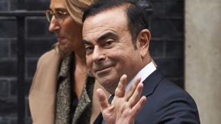 Carlos Ghosn leaving Downing Street