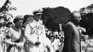 Ceylon, Colombo, The Queen Elizabeth Ii In Coronation Robes And The Duke Leaving The Independence Memorial Hall, In April 1954.