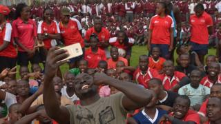 Kenya's Collins Injera poses for a selfie during a clinic held for high-school rugby players at the training camp for the Kenyan rugby sevens team (the Shujaas) for the Rio Olympics at Nandi county near Eldoret. Monday 18 July 2016