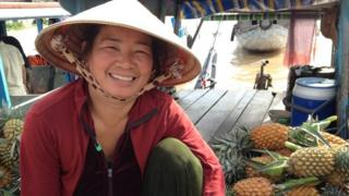 Bin Thui is a fruit seller at the Cai Rang floating fruit and vegetable market near Can Tho in Vietnam, in August 2015.