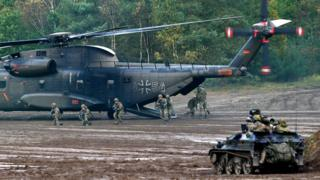 """A CH-53 heafy-lift transport helicopter of the German armed forces Bundeswehr operates in the context of an informative educational practice """"Land Operation Exercise 2017"""" at the military training area in Munster, northern Germany."""