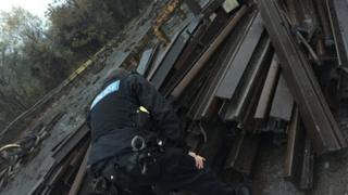 Man inspecting rail track
