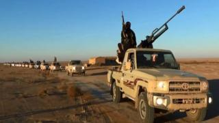 ISIL / ISIS militants on a vehicle driving in Niveneh province, Iraq, June 11 2014