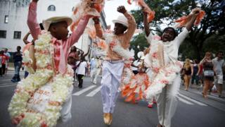 The Original Big 7 Junior Steppers parade through the Central Business District in a second line parade to mark the tenth anniversary of Hurricane Katrina in New Orleans, Louisiana August 29, 2015.