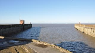 Looking out to the estuary from dockside showing the potential gap
